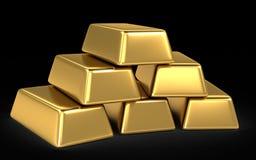 Barras y monedas de oro Foto de archivo libre de regalías