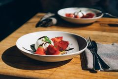 Barrata and tomatoes on a plate stock images