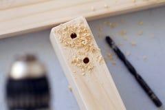 Barre di legno che sono perforate Fotografia Stock