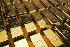 Barre di oro e concetto finanziario, colpi dello studio immagini stock libere da diritti
