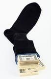 Barre du dollar dans une chaussette Image stock