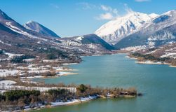 Barrea Lake on a sunny winter morning. Abruzzo, Italy. Barrea is a comune in the province of L`Aquila in the Abruzzo region of Italy. It is located on the shore stock photos