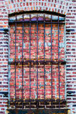 Barred brick window Royalty Free Stock Images
