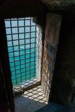 Barred Castle Doorway. In shadow looking over Lake Geneva Royalty Free Stock Photo
