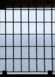 Barred prison window. With ocean view Stock Image
