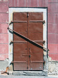Barred steel door Stock Photography