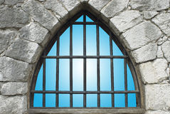 Barred window. In stone wall of castle Stock Images