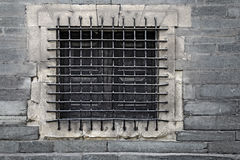 Barred Window. In a stone wall Stock Photography