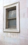 Barred window. A barred window on a marble wall royalty free stock photography