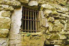 Barred Window. A barred window in a rock wall Stock Images