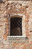 Barred window in a brick wall. Barred window in a dilapidated brick wall Royalty Free Stock Image
