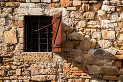 Barred window. Crushed stone wall detail with a barred window Stock Photography