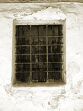 Barred window in Nerja, a sleepy Spanish Holiday resort on the Costa Del Sol  near Malaga, Andalucia, Spain, Europe. Nerja is located 53 kilometres east of Má Royalty Free Stock Photo