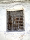 Barred window in Nerja, a sleepy Spanish Holiday resort on the Costa Del Sol  near Malaga, Andalucia, Spain, Europe. Nerja is located 53 kilometres east of Má Royalty Free Stock Image