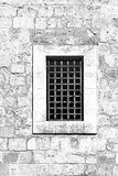 Barred Window in Old Acre. Barred window of traditional stoned house in old Acre. Window in the old city of Akko in Israel. Black and white picture Royalty Free Stock Photography