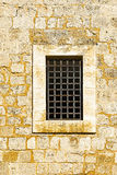 Barred Window in Old Acre. Barred window of traditional stoned house in old Acre. Window in the old city of Akko in Israel Royalty Free Stock Photo