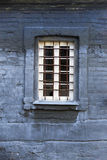 Barred window on an old brick building Stock Photo