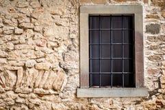 Window in stone wall. Barred window. royalty free stock photo
