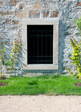 Barred window. In old stone wall on castle Royalty Free Stock Photos