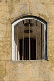 Barred window opening Royalty Free Stock Photo