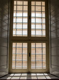Barred window with shadows Royalty Free Stock Photos