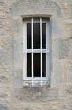 Barred window. A small window with bars set in a stone wall Stock Photos
