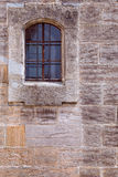 Barred window in stone wall Stock Images