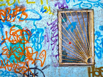 Barred window, wall with graffity. Background Royalty Free Stock Image