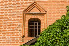 Barred window on the wall of an old manor. Barred window on the wall of an old brick manor Royalty Free Stock Photos