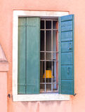 Barred window with wooden shutters. Element of European house royalty free stock images