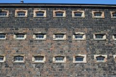 Barred windows on wall of prison Royalty Free Stock Photography