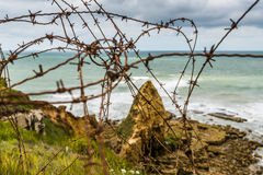 Barred wire on the cliffs of Pointe Du Hoc, Normandy Royalty Free Stock Photos