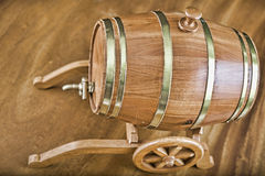 Barrel. Wooden barrel with tap and lid on wooden background Royalty Free Stock Photos