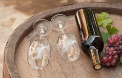 Barrel. Glasses of wine on a wine barrel stock photos