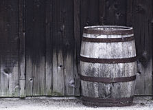 Barrel. An old wooden barrel next to a barn Royalty Free Stock Photo