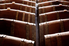 Old wine barrels. Rows of old wine barrels in a cellar Royalty Free Stock Images