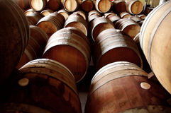 Barrel Abstract VII. Abstract of rows of old wine barrels in cellar Royalty Free Stock Images