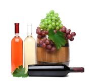 Barrel And Bottles Of Wine With Ripe Grapes Royalty Free Stock Image