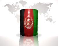 barrel avec le drapeau afghan sur la carte du monde Photographie stock