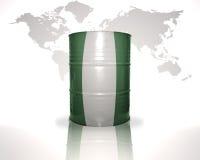 Barrel avec le drapeau nigérien sur la carte du monde Photographie stock libre de droits