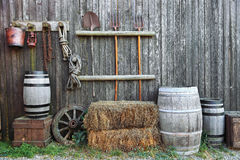 Barrel bale and fork in old barn Royalty Free Stock Photos