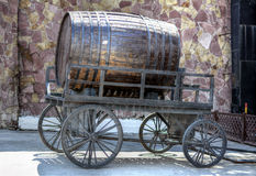 A barrel of beer on a wooden cart.  royalty free stock photos