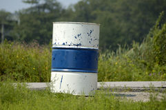 Barrel - blue & white. A blue & white striped garbage barrel Royalty Free Stock Photo