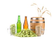 Barrel and bottles of beer with hop. Royalty Free Stock Image