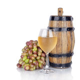 Barrel, bottles and glass of wine and ripe grapes  Stock Photo