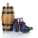 Barrel, bottles and glass of wine and ripe grapes  Royalty Free Stock Image
