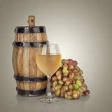 Barrel, bottles and glass of wine and ripe grapes Royalty Free Stock Photography