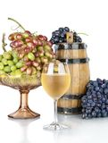 Barrel, bottles and glass of wine  on white Royalty Free Stock Photo