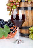 Barrel, bottles, grapes and glass of  red wine Royalty Free Stock Images
