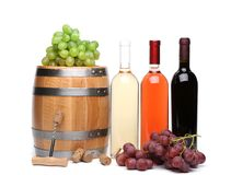 Barrel and bottles of wine Stock Photos